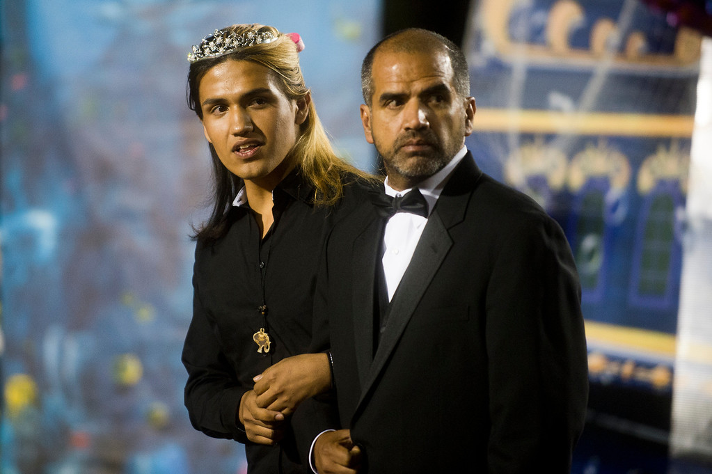 . Patrick Cordova, 16, a transgender senior, left, awaits the announcement of the Azusa High 2013 Homecoming Queen with dad, Jose Cordova, during halftime at Citrus College Stadium in Glendora on Friday night, Sept. 27, 2013. (Photo by Watchara Phomicinda/ San Gabriel Valley Tribune)
