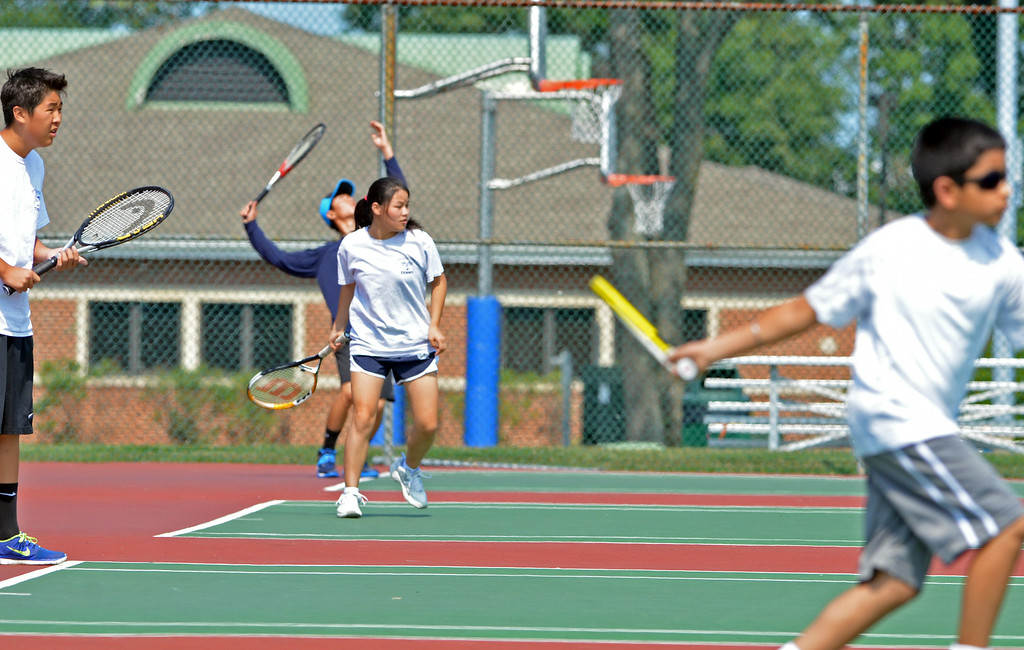 . Players fill the courts at the UG Open Teen Tennis Tournament in Upper Gwynedd.    Friday,  August 8, 2014.   Photo by Geoff Patton