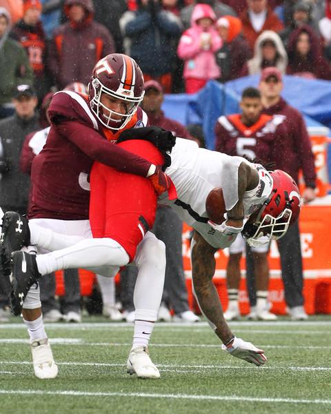 Virginia Tech cornerback #3 Caleb Farley tackles Cincinati wide receiver #1 Kahlil Lewis