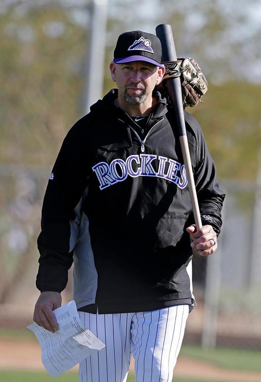 . Colorado Rockies manager Walt Weiss watches a spring training baseball workout Tuesday, Feb. 12, 2013, in Scottsdale, Ariz. (AP Photo/Darron Cummings)