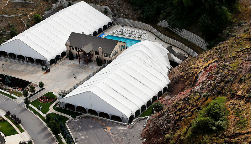 . The Eagleridge Swim and Tennis Club works is damaged following a landslide in a hillside community of North Salt Lake, Utah, Tuesday, Aug. 5, 2014. One home has been destroyed and at least a dozen others have been evacuated.  (AP Photo/The Deseret News, Ravell Call)