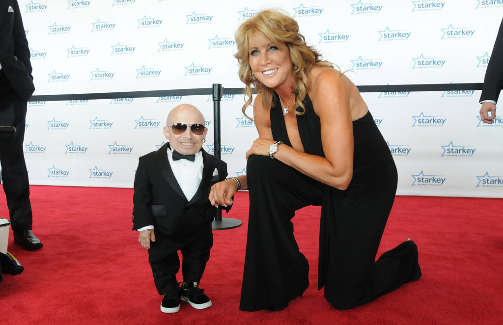 . Actor Verne Troyer poses with basketball hall of famer and two-time Olympian Nancy Lieberman on the red carpet at RiverCentre. (Ginger Pinson: Pioneer Press)