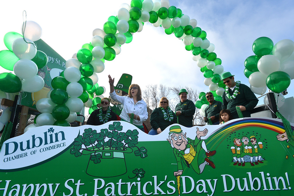. Dublin Chamber of Commerce members wave to the crowd as their float goes down Dublin Boulevard during the Saint Patrick\'s Day Parade in Dublin, Calif., on Saturday, March 16, 2013. (Dan Rosenstrauch/Staff)