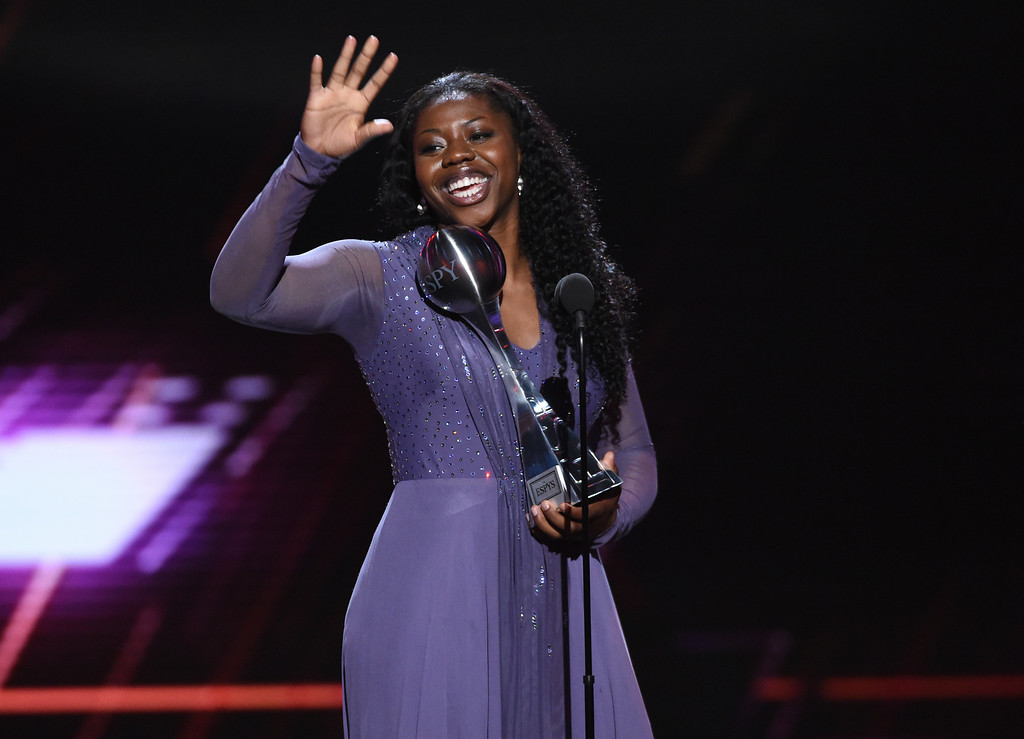 . Notre Dame basketball player Arike Ogunbowale accepts the award for best play for her buzzer-beater to win the women\'s NCAA basketball championship, at the ESPY Awards at Microsoft Theater on Wednesday, July 18, 2018, in Los Angeles. (Photo by Phil McCarten/Invision/AP)