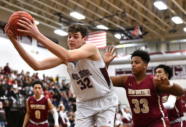 1/3/2020 Mike Orazzi | StaffrBristol Central High School's Donovan Clingan (32) and New Britain's Dontay Bishop (33) during Friday night's boys basketball game in Bristol.