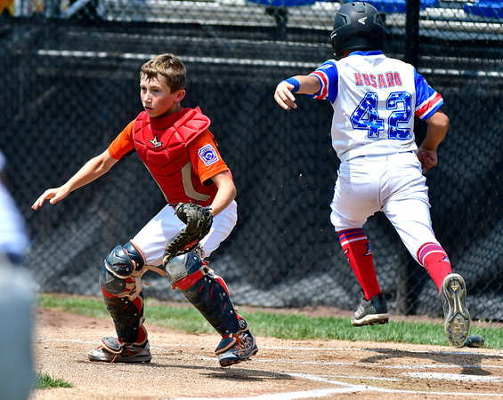 8/7/2019 Mike Orazzi | Staff Pennsylvania's Lucas Martz (22) as New Jersey J.R. Rosado (42) scores during Wednesday's Eastern Regional Little League Baseball game at Breen Field in Bristol.