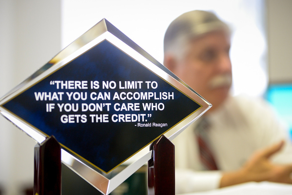 """. L.A. County Interim Sheriff John Scott, has a plaque on his desk with a Ronald Reagan quote that says, \""""there  is no limit to what you can accomplish if you don\'t care who gets the credit.\"""" (Photo by Michael Owen Baker/L.A. Daily News)"""