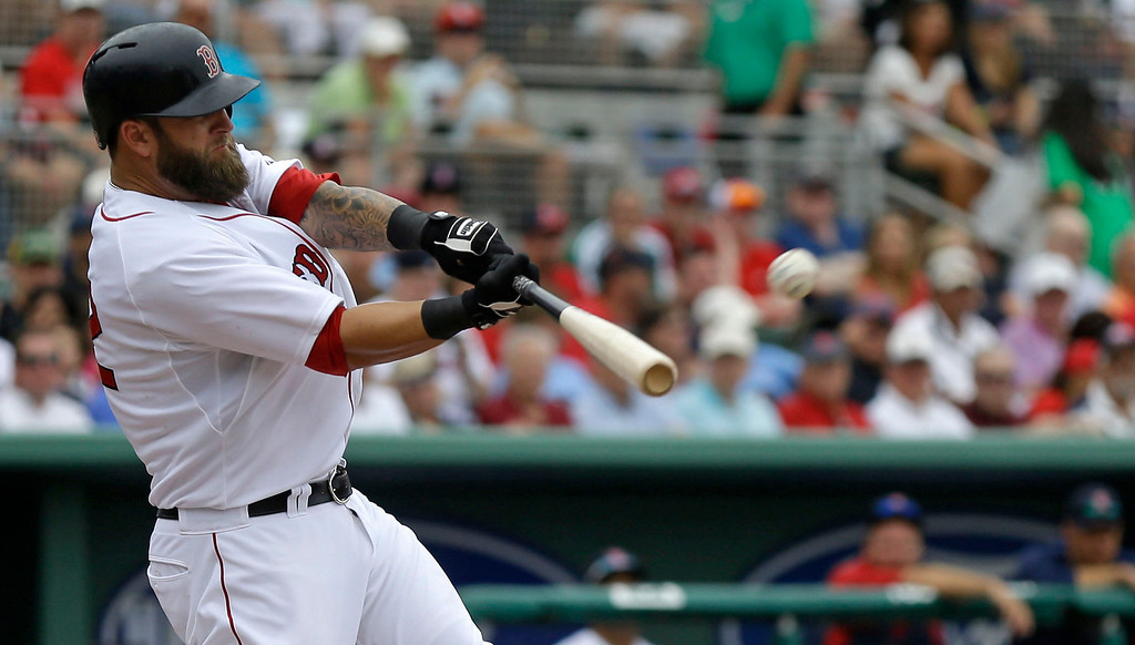 . Boston Red Sox Mike Napoli hits a solo homer during the second inning of an exhibition baseball game against the Minnesota Twins in Fort Myers, Fla., Saturday, March 29, 2014. (AP Photo/Gerald Herbert)