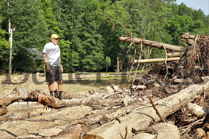 Tom Phillips looks over downed trees that formed a log jam completely rerouting Little Buffalo Creek. Flooding  washed away two of his sand volleyball courts. Seb Foltz/Butler Eagle