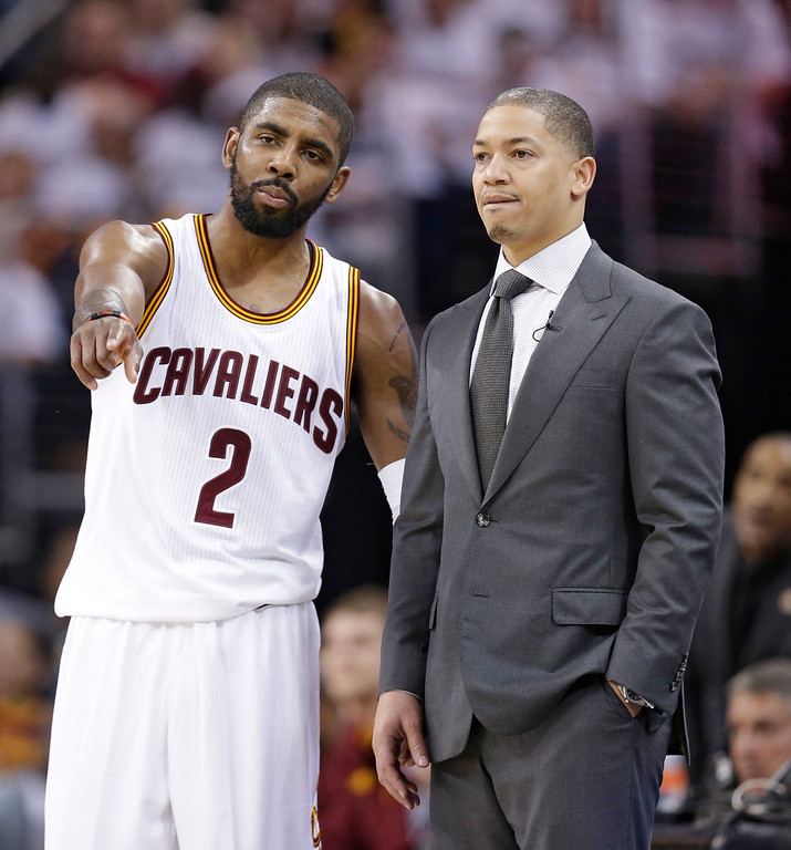. Cleveland Cavaliers\' Kyrie Irving, left, talks with head coach Tyronn Lue in the second half in Game 2 of a first-round NBA basketball playoff series against the Detroit Pistons, Wednesday, April 20, 2016, in Cleveland. (AP Photo/Tony Dejak)