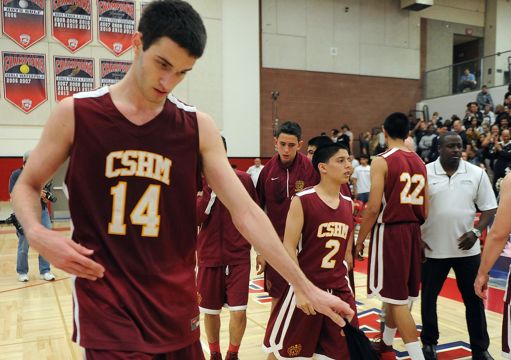 . Cantwell\'s Balsa Dragovic (14) walks off the court as Bishop Montgomery defeated Cantwell 66-56 during a CIF Southern California Regional Division IV basketball game at Colony High School in Ontario, Calif., on Saturday, March 22, 2014.  (Keith Birmingham Pasadena Star-News)