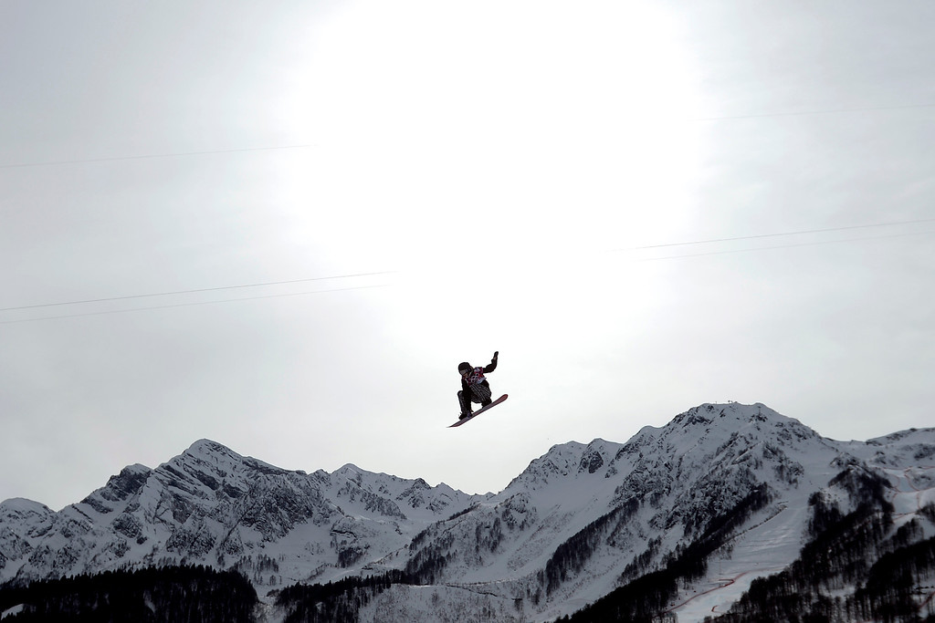 . ROSA KHUTOR, RUSSIA - FEBRUARY 09: Enni Rukajarvi, of Finland, makes a grab on her final jump en route to a silver medal during the women\'s snowboard slopestyle final. Sochi 2014 Winter Olympics at the Rosa Khutor Etreme Park on Sunday, February 9, 2014. (Photo by AAron Ontiveroz/The Denver Post)