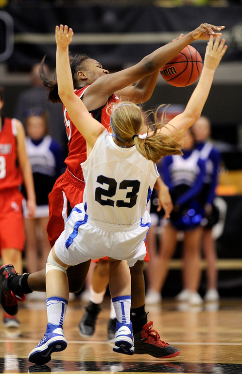. BOULDER, CO. - MARCH 16: Regis center Diani Akigbogun (15) collided with Falcons guard Shelby Hickey (23) in the second half. The Regis Jesuit High School girl\'s basketball team defeated Highlands Ranch 53-46 in the 5A championship game Saturday, March 16, 2013 at the Coors Events Center in Boulder.  (Photo By Karl Gehring/The Denver Post)