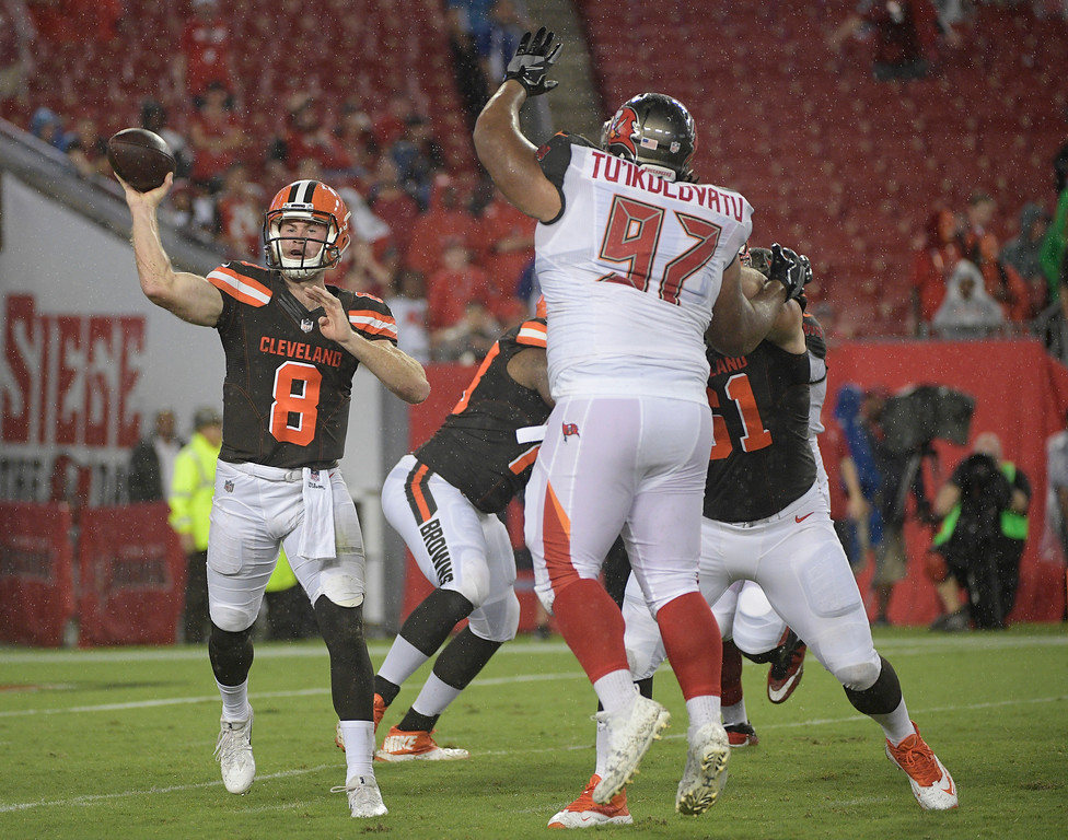 . Cleveland Browns quarterback Kevin Hogan (8) throws a pass over Tampa Bay Buccaneers nose tackle Stevie Tu\'ikolovatu (97) during the fourth quarter of an NFL preseason football game Saturday, Aug. 26, 2017, in Tampa, Fla. (AP Photo/Phelan Ebenhack)