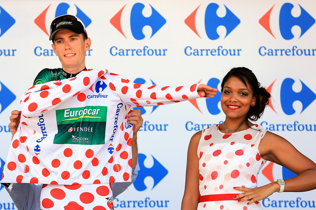 . Pierre Roland of France riding for Europcar takes to the podium as he defended the mountain climber\'s polka dot jersey in stage three of the 2013 Tour de France, a 145.5KM road stage from Ajaccio to Calvi, on July 1, 2013 in Calvi, France.  (Photo by Doug Pensinger/Getty Images)