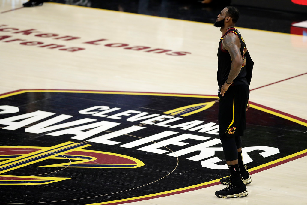 . Cleveland Cavaliers\' LeBron James watches during the first half of Game 4 of basketball\'s NBA Finals against the Golden State Warriors, Friday, June 8, 2018, in Cleveland. (AP Photo/Tony Dejak)