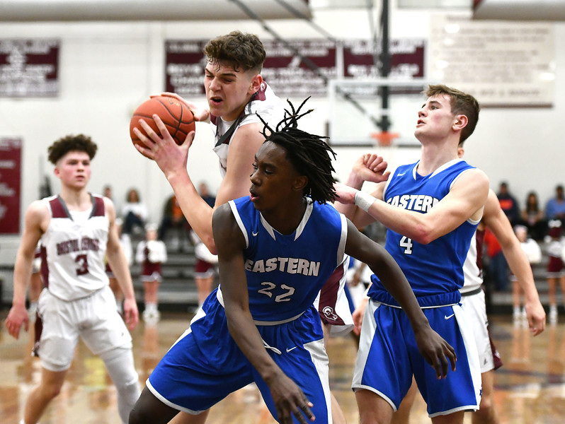 1/24/2020 Mike Orazzi | Staff Bristol Central High School's Donovan Clingan (32)and Bristol Eastern's Jordyn Tate (22) during Friday night's boys basketball game at Central.