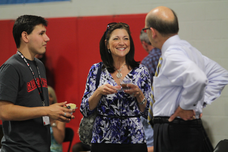 President Bonner talks to a perspective student and his mother at Accepted Student's Day.