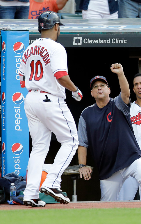 . Cleveland Indians manager Terry Francona, right, congratulates Edwin Encarnacion after Encarnacion hit a solo home run off Toronto Blue Jays starting pitcher Marco Estrada during the second inning of a baseball game, Friday, July 21, 2017, in Cleveland. (AP Photo/Tony Dejak)