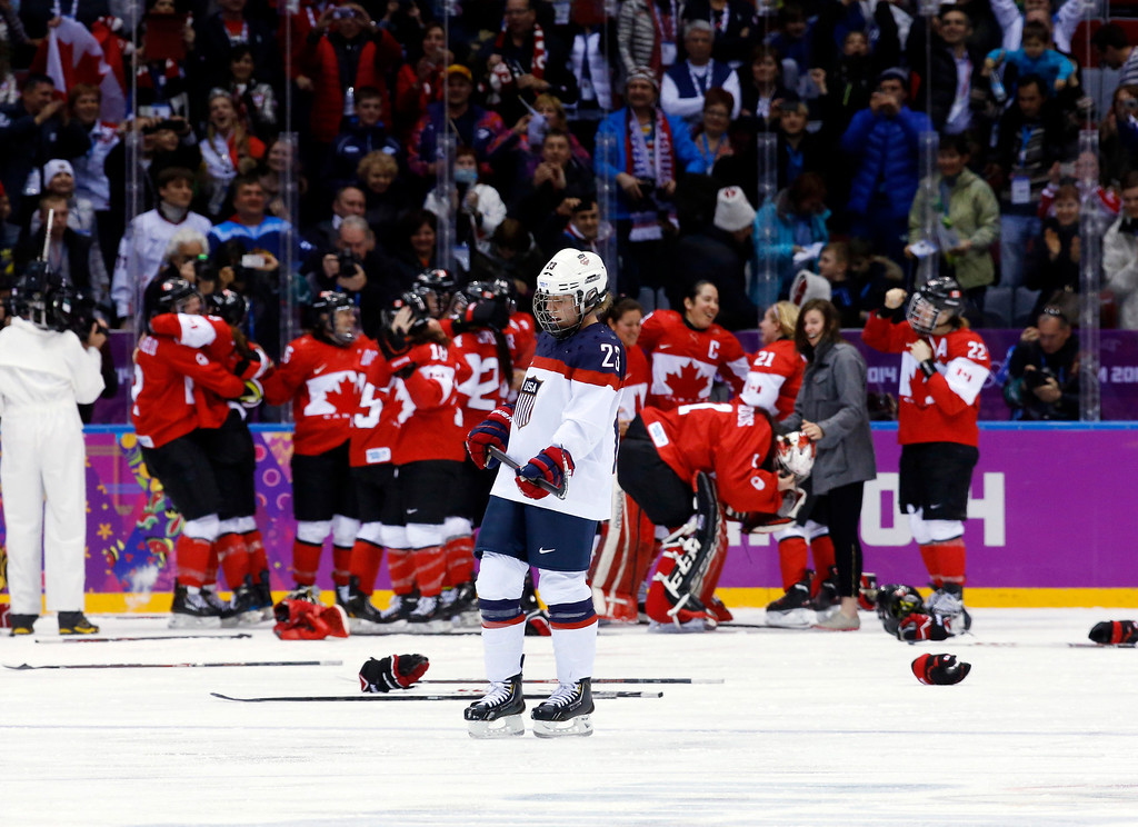 . Michelle Picard of the United States (23) skates back to the bench after Canada scored in overtime to win the women\'s gold medal ice hockey game 3-2 at the 2014 Winter Olympics, Thursday, Feb. 20, 2014, in Sochi, Russia. (AP Photo/Matt Slocum)