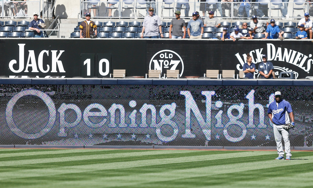. Los Angeles Dodgers right fielder Yasiel Puig stands alone in the outfield during pregame activities before the opening game of Major League baseball in the United States between the Los Angeles Dodgers and San Diego Padres Sunday, March 30, 2014, in San Diego.  (AP Photo/Lenny Ignelzi)