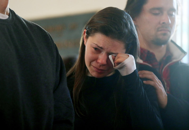 . A woman reacts at a prayer service to reflect on the violence at Sandy Hook Elementary School at a church on December 15, 2012 in Newtown, Connecticut. Twenty six people were shot dead, including twenty children, after a gunman identified as Adam Lanza opened fire in the school. Lanza also reportedly had committed suicide at the scene. A 28th person, believed to be Nancy Lanza was found dead in a house in town, was also believed to have been shot by Adam Lanza.  (Photo by Mario Tama/Getty Images)