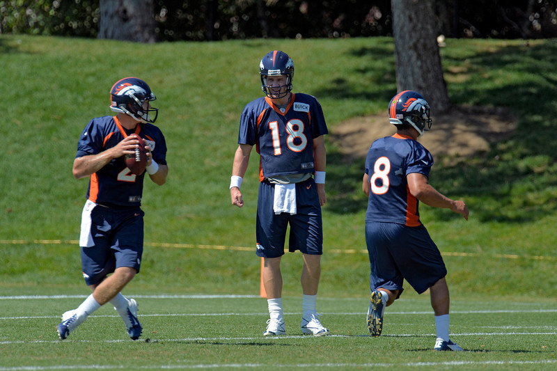 . Denver Broncos quarterback Peyton Manning (18) watches Zac Dysert (2) drop s back for a pass during practice August 19, 2013 at Dove Valley (Photo by John Leyba/The Denver Post)