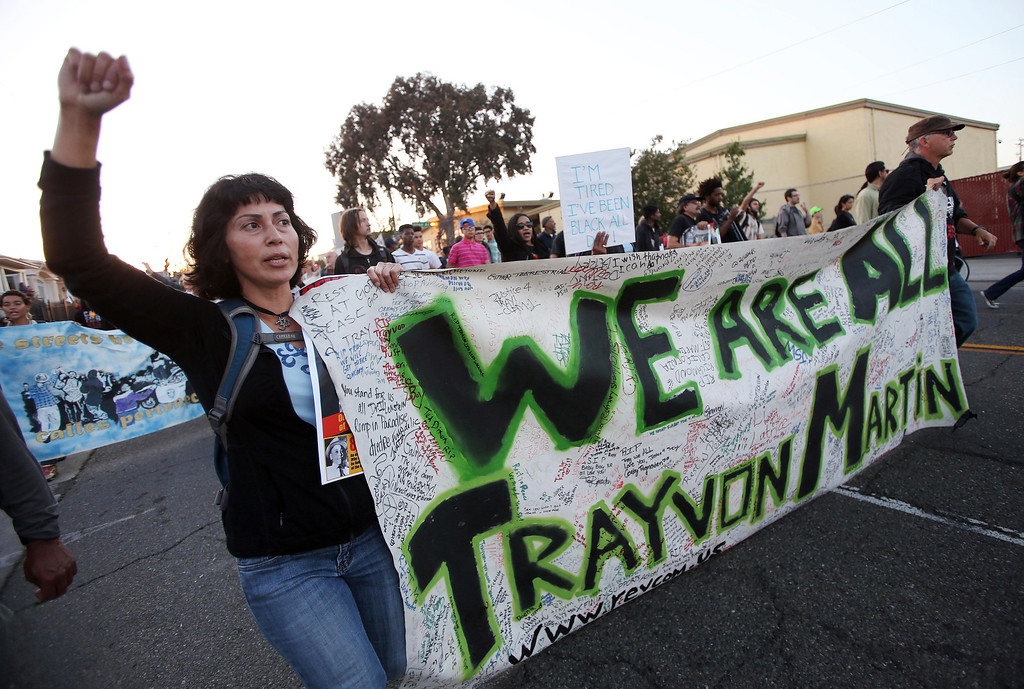 . Diya Cruz, left, marches from Frank Ogawa Plaza to the Fruitvale BART station with other protesters after a rally in Oakland, Calif., on Friday, July 19, 2013. People gathered to demonstrate in the week following the acquittal of George Zimmerman in the shooting death of Trayvon Martin. (AP Photo/Bay Area News Group, Jane Tyska)