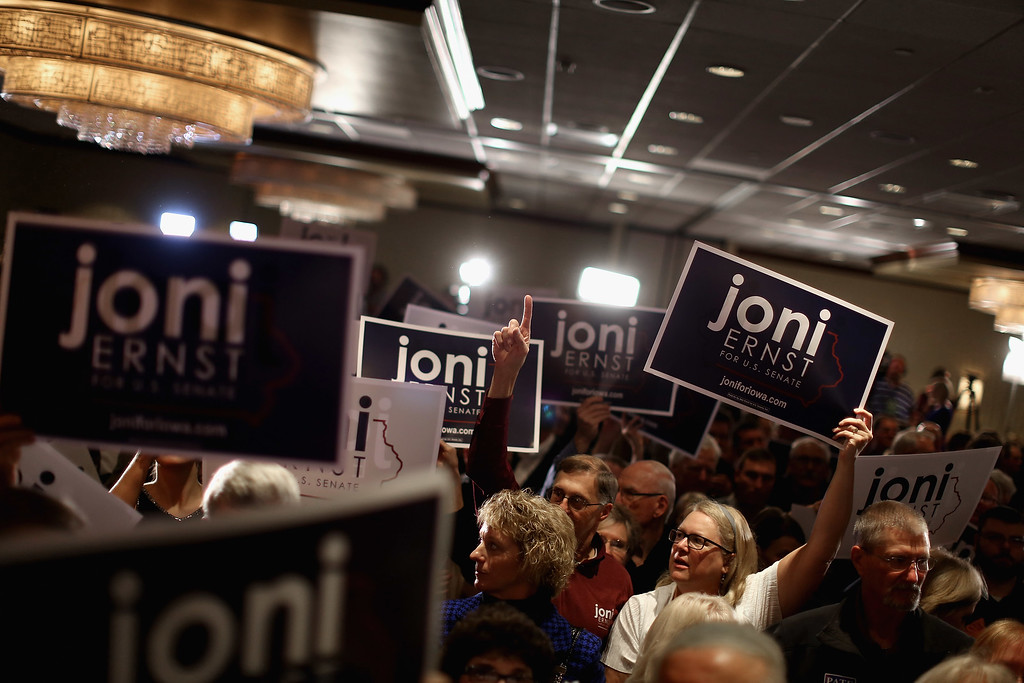 . WEST DES MOINES, IA - NOVEMBER 04:  Supporters celebrate after hearing that Republican candidate Joni Ernst won the U.S. Senate race on election night at the Marriott Hotel November 4, 2014 in West Des Moines, Iowa. Ernst and her opponent Democrat Rep. Bruce Braley (D-IA) were locked in a months-long campaign battle that had them tied in the polls going into election day.  (Photo by Chip Somodevilla/Getty Images)