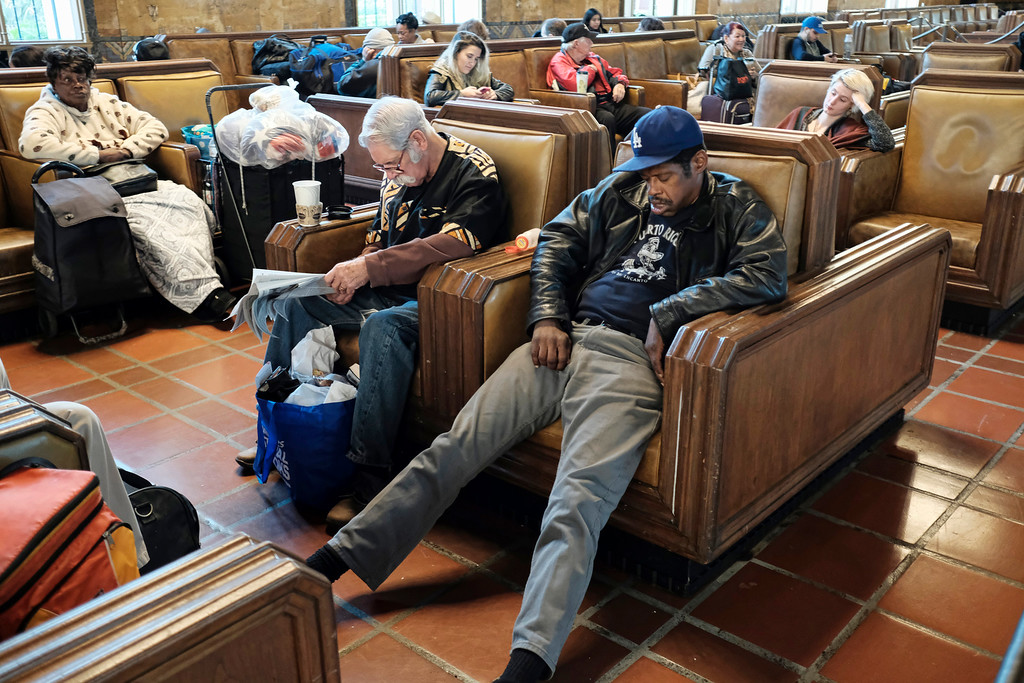 . Railroad travelers and homeless people wait at Union Station in downtown Los Angeles on Wednesday, Nov. 23, 2016. As tens of millions of Americans take to the roads, airports and railways for the Thanksgiving holiday, many are hoping to take a break from the rancor and division of the presidential election and focus instead on family and tradition. (AP Photo/Richard Vogel)