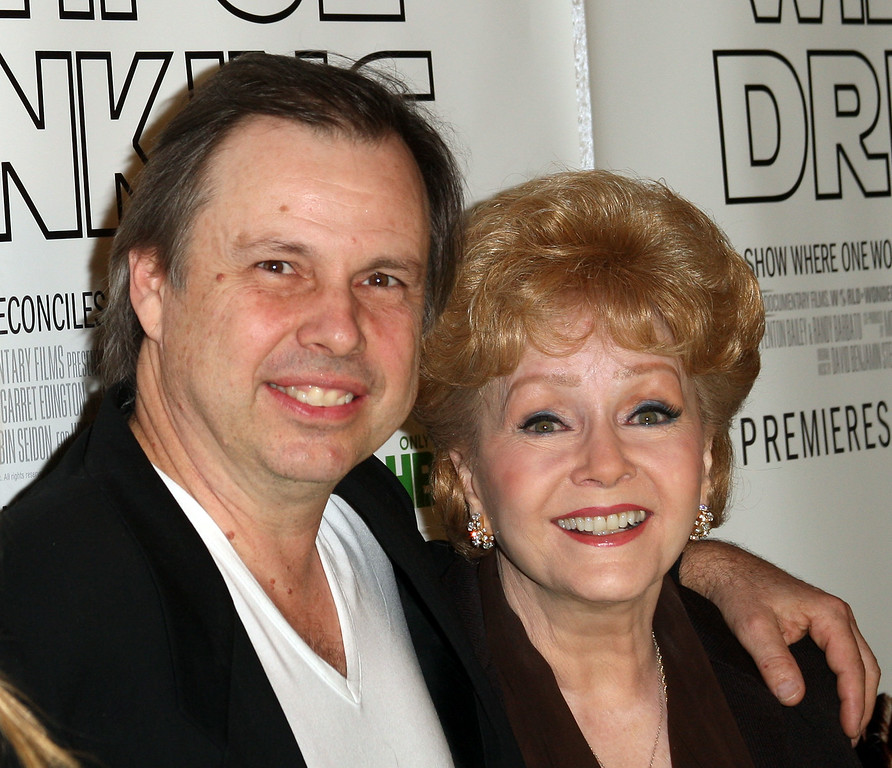 ". Actor Todd Fisher (L) and actress Debbie Reynolds attend the premiere of the HBO Documentary ""Wishful Drinking\"" at the Linwood Dunn Theater on December 7, 2010 in Hollywood, California.  (Photo by Frederick M. Brown/Getty Images)"