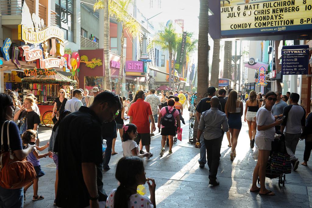. People walk through Universal CityWalk. Friday, July 6, 2013. (Michael Owen Baker/L.A. Daily News)