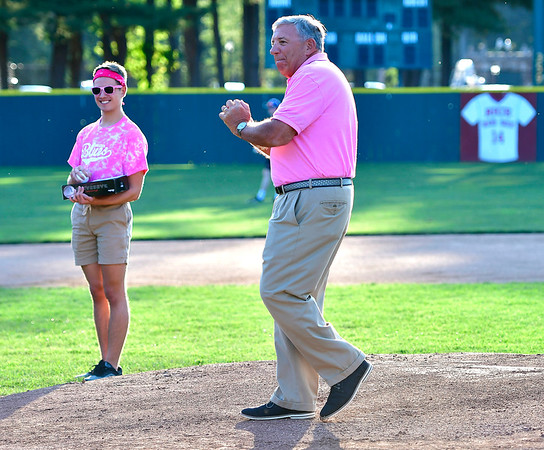 8/1/2019 Mike Orazzi | Staff John Lodovico, Vice Chair of the Bristol Health Board of Directors, throws out one of the first pitches during Pink Night at the Bristol Blues at Muzzy Field on Thursday evening.