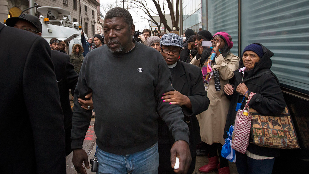 . ADDS RELATIONSHIP OF CARR TO GARNER AS STEPFATHER - Benjamin Carr, stepfather of Eric Garner, leaves the district attorney\'s office after a grand jury\'s decision not to indict a New York police officer involved in Garner\'s death, Wednesday, Dec. 3, 2014, in the Staten Island borough of New York. The decision not to indict Officer Daniel Pantaleo added to the tensions that have simmered in the city since Garner\'s death on July 17.(AP Photo/John Minchillo)