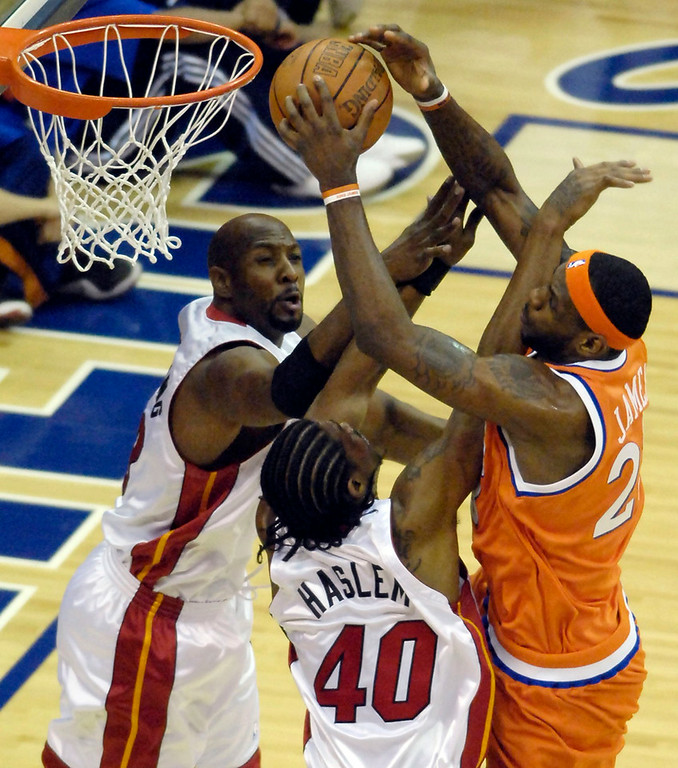 . Michael Blair/MBlair@News-Herald.com The cavs LeBron James is fouled by Udonis Haslem as heat teammate Alonzom Mourning defends, left, during the first quarter of Thursday night\'s game at The Q.