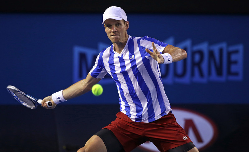 . Tomas Berdych of the Czech Republic  makes a forehand return to Stanislas Wawrinka of Switzerland during their semifinal at the Australian Open tennis championship in Melbourne, Australia, Thursday, Jan. 23, 2014.(AP Photo/Aaron Favila)