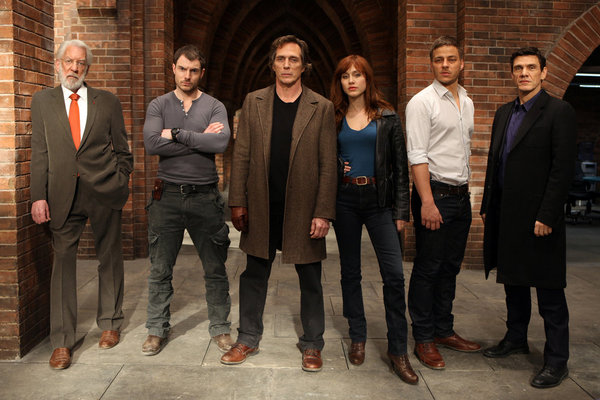 . CROSSING LINES -- Season: 1 -- Pictured: (l-r) Donald Sutherland as Dorn, Richard Flood as Tommy McConnel, William Fichtner as Carl Hickman, Gabriella Pession as Eva Vittoria, Tom Wlaschiha as Sebastian Berger and Marc Lavoine as Louis Bernard -- (Photo by: Dusan Martincek/Tandem)