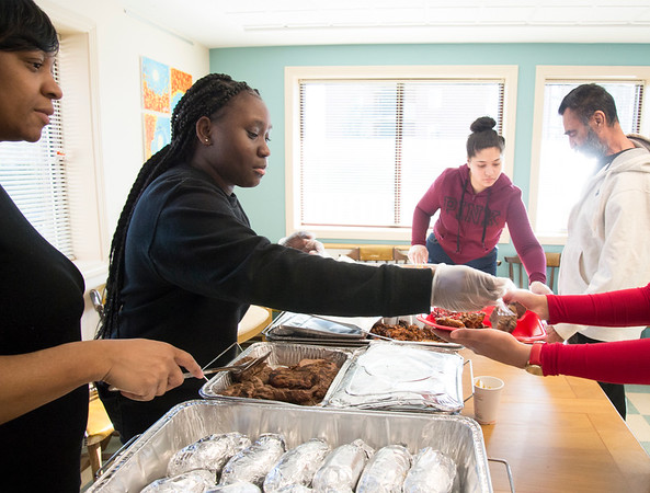 12/20/19 Wesley Bunnell | StaffrrMarie Sergeant supervises as Yhaaira Shaw serves holiday meals at Howey House on Monday afternoon as part of her Capstone Project along with three other seniors. Howey House is a part of shelter for chronically homeless persons.