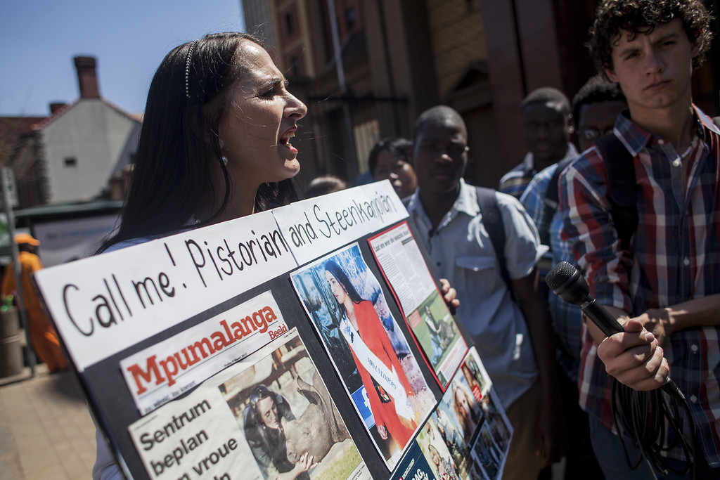 . A protester talks to members of the public and media outside the North Gauteng High Court on September 11, 2014 in Pretoria, South Africa.  (Charlie Shoemaker/Getty Images)