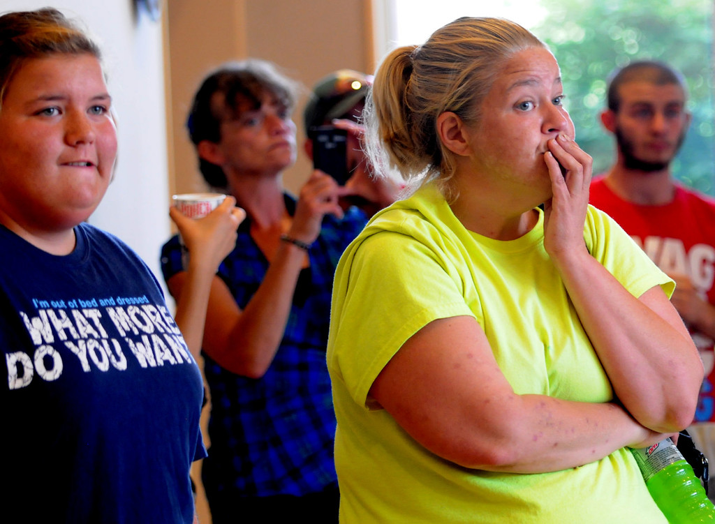 . Tara Swanson of Centuria, Wis., right, and her daughter Kiarra Swanson, left, listen to Chief Deputy Steven Moe speak to the press at the Polk County Justice Center on Thursday. Tara said she and her husband helped search for Isaiah Theis for about 28 hours. (Pioneer Press: Jean Pieri)