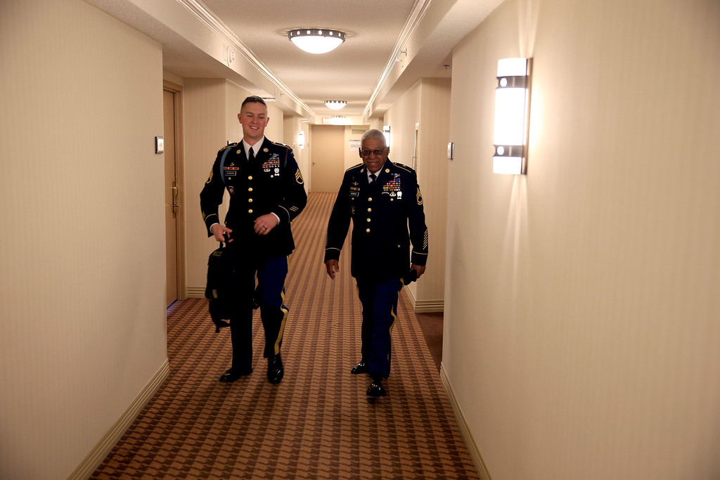 . U.S. Army Staff Sgt. (Ret.) Melvin Morris (R), a Vietnam War veteran, and U.S. Army Staff Sergeant Christopher Schneider, from U.S. Army Old Guard, 3d U.S. Infantry Regiment, walk together as they make their to the White House on March 18, 2014 in Washington,DC.   (Photo by Joe Raedle/Getty Images)