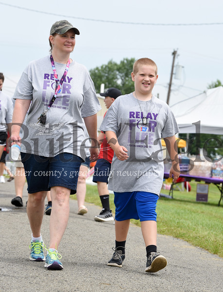 Harold Aughton/Butler Eagle: Tina Ruffner of Sarver, and her son, Andy, 9, joined the United Plate Glass team to raise funds for the American Cancer Society Saturding during the Relay for Life event.