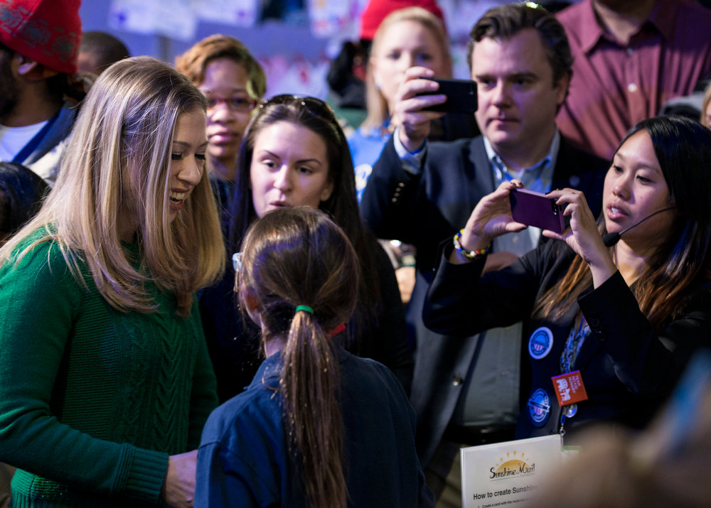 . Chelsea Clinton speaks with people at a service summit on the National Mall January 19, 2013 in Washington, DC. Events around the Inauguration started with a national day of service a yearly event where Americans are encouraged to volunteer and contribute to service projects to honor American civil rights leader Martin Luther King. BRENDAN SMIALOWSKI/AFP/Getty Images