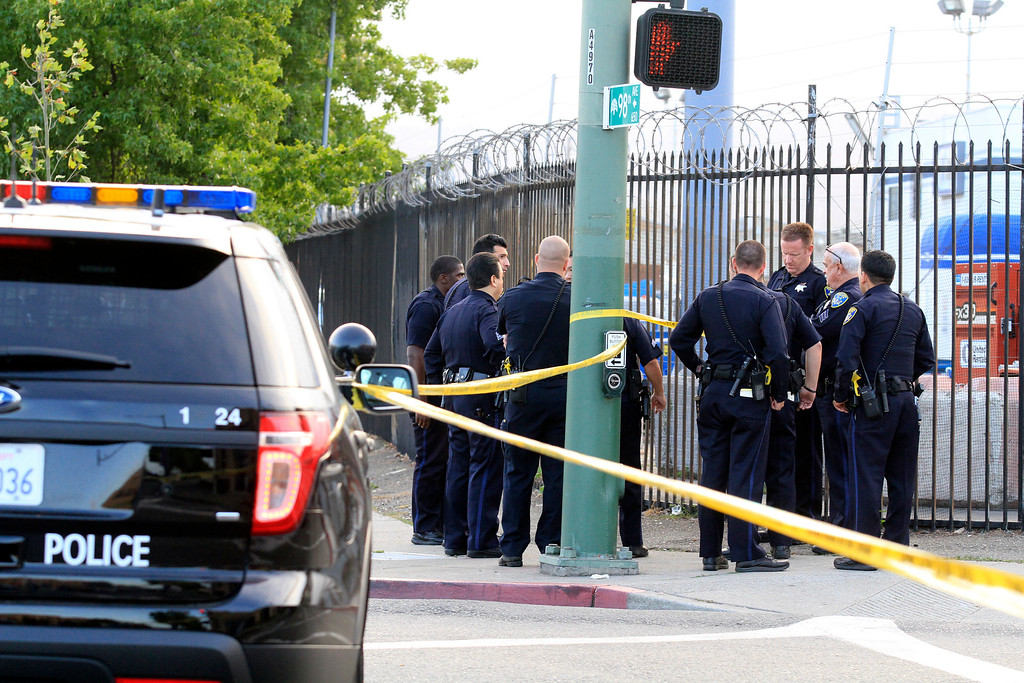 . Oakland police investigate a white truck believed to be involved in a shooting of a Hayward police officer that was found on Edes and 98th Avenues in Oakland, Calif., on Wednesday, July 22, 2015. (Laura A. Oda/Bay Area News Group)