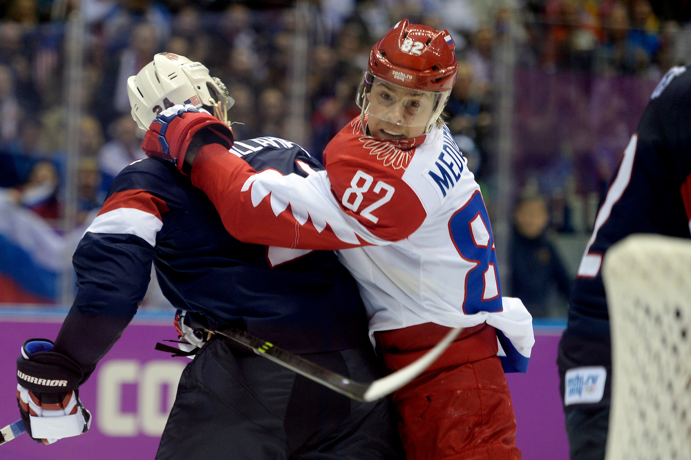 . Yevgeni Medvedev (82) of the Russia holds Ryan Callahan (24) of the U.S.A. as things get physical early during the first period of men\'s hockey action at Bolshoy arena. Sochi 2014 Winter Olympics on Saturday, February 15, 2014. (Photo by AAron Ontiveroz/The Denver Post)