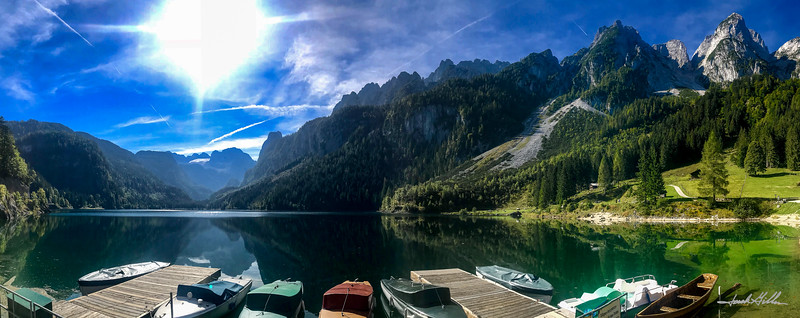 Dock with boats on Lake Gosau (Gosausee) surrounded by the Dachstein Mountains