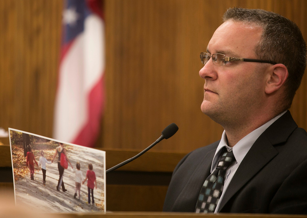 . Michael Allen Blair/MBlair@News-Herald.com Witness David Strunk, friend of Kevin Knoefel holds a photograph of Sabrina Zunich with his children from a camping trip in the days before the murder of Lisa Knoefel. Strunk was testifying on day Three of Knoefel\'s murder conspiracy trial in Lake County Common Pleas Court on  June 4, 2014.