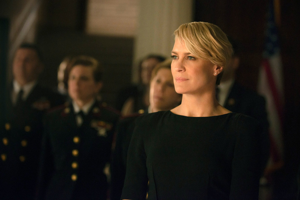 """. This image released by Netflix shows Robin Wright as Clair Underwood in a scene from \""""House of Cards.\""""  Wright was nominated for a Golden Globe for best actress in a drama series for her role on the show, on Thursday, Dec. 11, 2014. The 72nd annual Golden Globe awards will air on NBC on Sunday, Jan. 11. (AP Photo/Netflix, Nathaniel E. Bell)"""