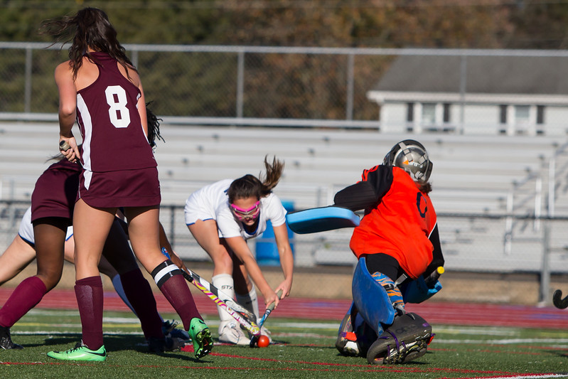 Southington's Megan Matthews scores on Windsor's Kayleigh Morgan Tuesday at Fontana Field in Southington October 17, 2017   Justin Weekes / For the Record-Journal