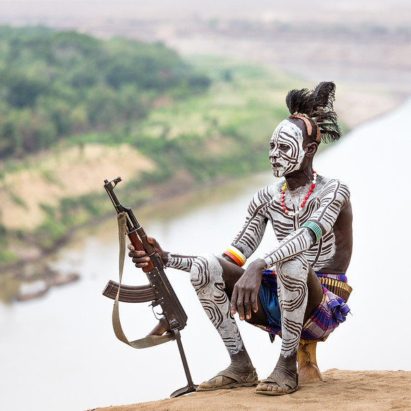 Karo men paint their bodies and faces with white chalk to look as fierce as possible. It's a daily routine that scares off enemies and also serves the purpose of making themselves more attractive to the opposite sex.